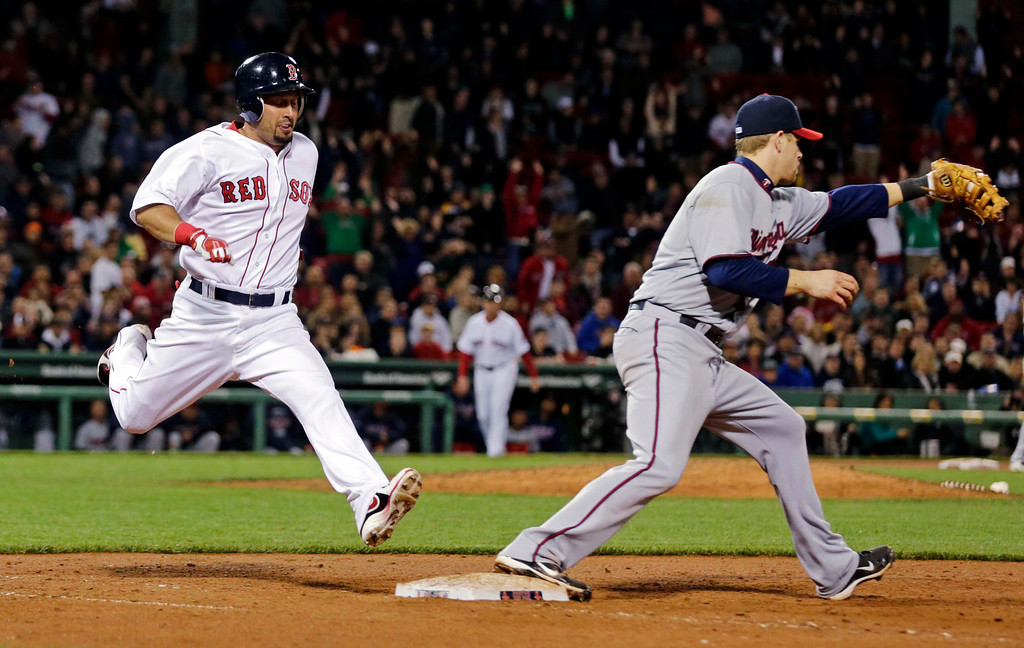 . Boston Red Sox\'s Shane Victorino, left, grounds out at first as Minnesota Twins first baseman Justin Morneau fields the throw during the seventh inning. (AP Photo/Charles Krupa)