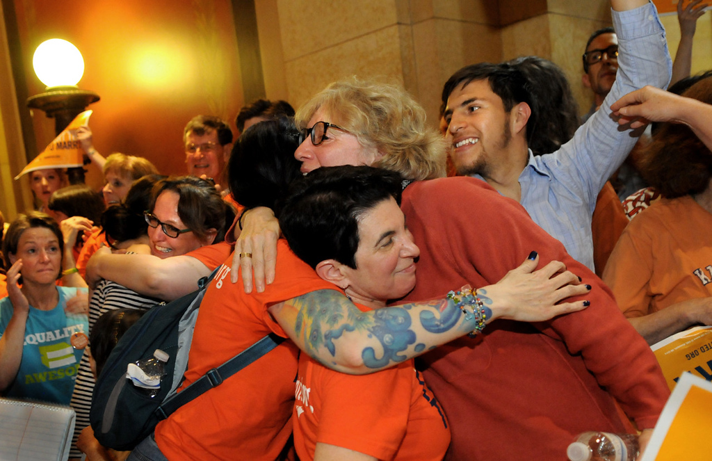 . Laura Boisen of Falcon Heights (glasses) hugs a friend after the Minnesota House of Representatives passed a bill allowing same-sex couples to marry. (Pioneer Press: Jean Pieri)