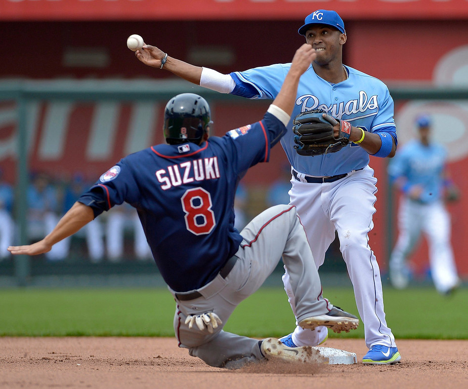 . Kansas City Royals shortstop Alcides Escobar (2) forces out the Minnesota Twins\' Kurt Suzuki (8) at second base, but is unable to complete the double play in the fourth inning. (John Sleezer/Kansas City Star/MCT)