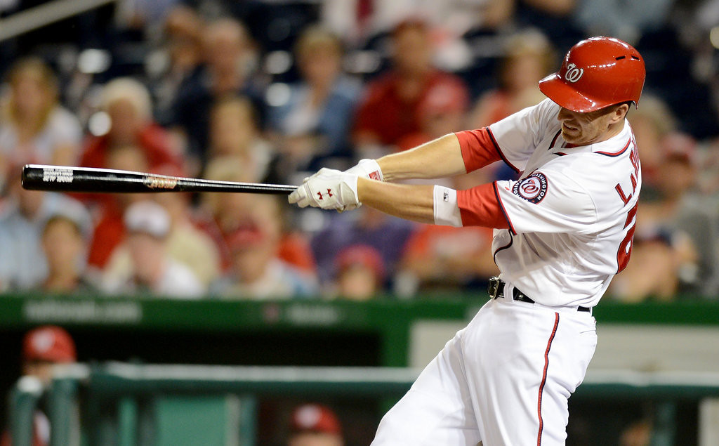 . Washington Nationals first baseman Adam LaRoche (25) strokes a long RBI sacrifice fly to right field against the Minnesota Twins in the fifth inning of the second game of a day-night doubleheader. (Chuck Myers/MCT)