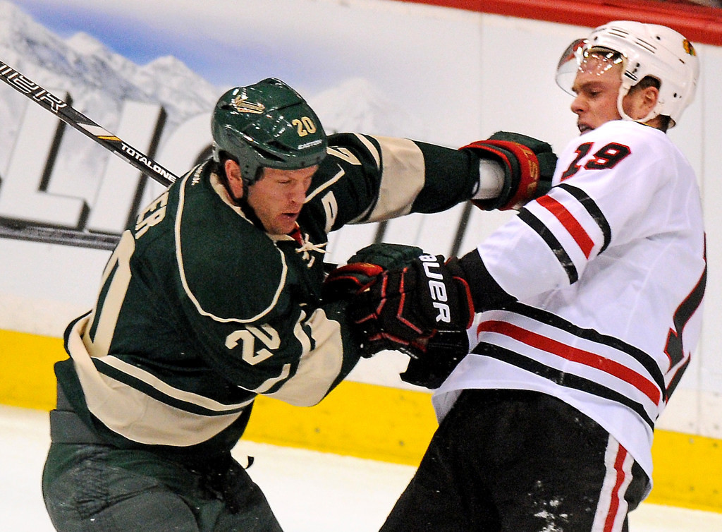 . Minnesota defenseman Ryan Suter, left,checks Chicago center Jonathan Toews off the puck in the Wild zone during in the first period. (Pioneer Press: John Autey)