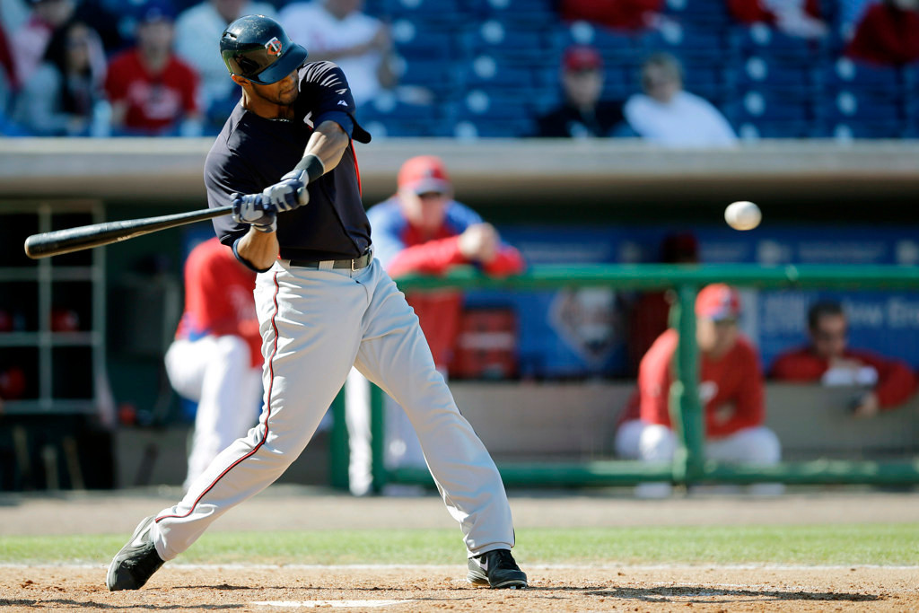 . Minnesota\'s Aaron Hicks hits a two-run home run off Philadelphia\'s\' Raul Valdes in the seventh inning of the Twins\' 10-6 split-squad win at Bright House Field in Clearwater, Fla., on Thursday, March 7, 2013. Hicks hit three homers and knocked in six runs in the game.  (AP Photo/Matt Slocum)