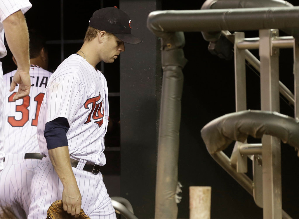 . Minnesota Twins\' Justin Morneau leaves the dugout after the Cleveland Indians beat the Twins. (AP Photo/Jim Mone)