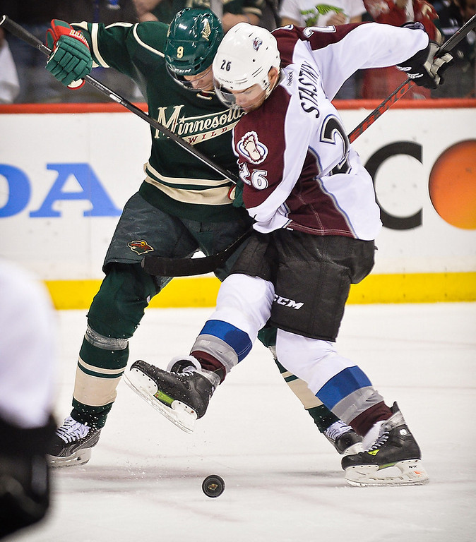 . Minnesota Wild center Mikko Koivu and Colorado Avalanche center Paul Stastny battle for the puck during the third period. (Pioneer Press: Ben Garvin)