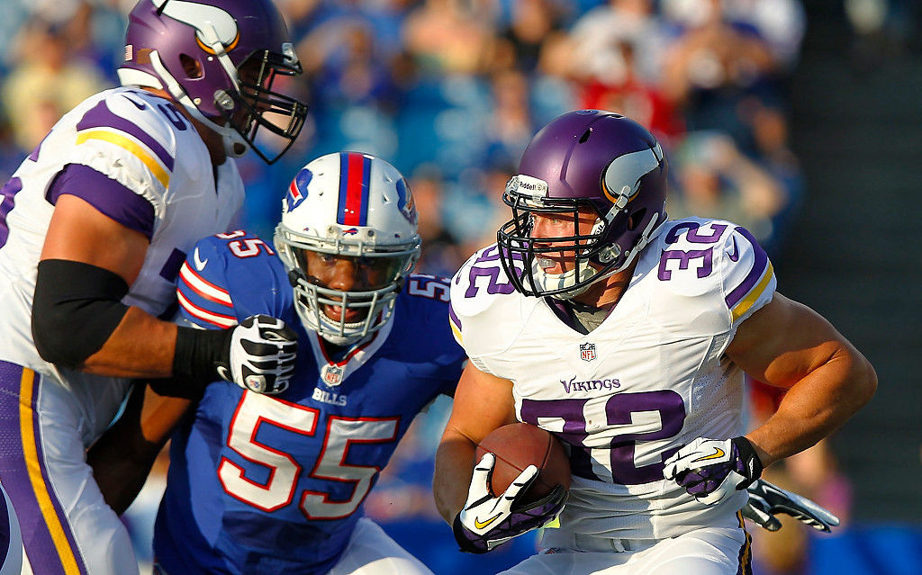. Minnesota Vikings running back Toby Gerhart (32) is chased by Buffalo Bills\' Jerry Hughes (55) during the first half of an NFL preseason football game Friday, Aug. 16, 2013, in Orchard Park, N.Y.  (AP Photo/Bill Wippert)