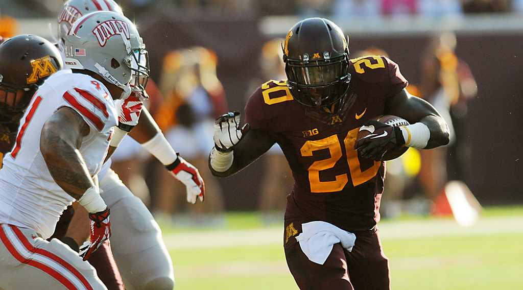 . Gophers running back Donnell Kirkwood hits the hole against UNLV during the first quarter.  (Pioneer Press: John Autey)