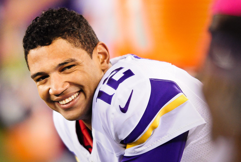 . Vikings quarterback Josh Freeman grins on the bench during the first quarter against the Giants.   (Pioneer Press: Ben Garvin)