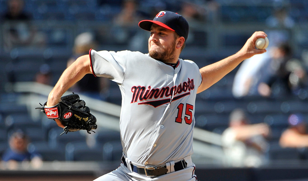 . Twins relief pitcher Glen Perkins works a scoreless ninth inning against the Yankees. (AP Photo/Kathy Kmonicek)