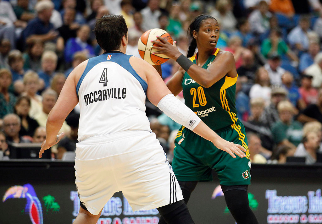 . Seattle Storm forward Camille Little (20) looks for opening to make a pass against Minnesota Lynx forward Janel McCarville (4) in the second half of a WNBA basketball game, Sunday, Aug. 4, 2013, in Minneapolis. The Lynx won 90-72. (AP Photo/Stacy Bengs)