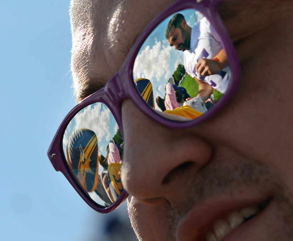 . Vikings offensive tackle Matt Kalil is reflected in the sunglasses of Nathan Gollnick of Flandreau, S.D., who is getting an autograph from Kalil on the last day of the team\'s training camp in Mankato on Wednesday, Aug. 14, 2013. (Pioneer Press: Chris Polydoroff)