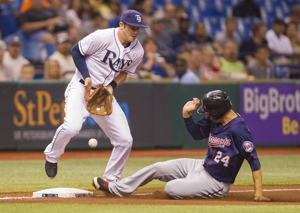 . Evan Longoria of the Tampa Bay Rays can\'t handle a throw, as Trevor Plouffe of the Minnesota Twins slides into third during the fourth inning.   (James Borchuck/Tampa Bay Times/MCT)