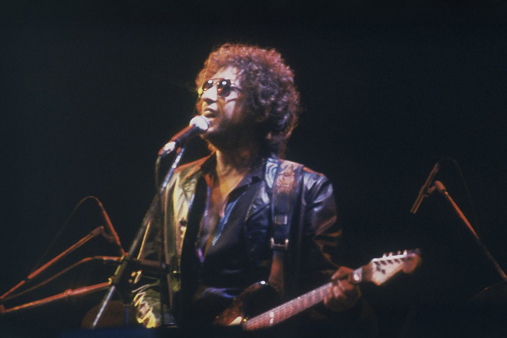 . American singer Bob Dylan performs at the Olympic Stadium in Colombes, France, before an estimated 40,000 fans, June 23, 1981. (AP Photo)