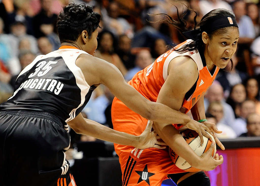 . East\'s Angel McCoughtry, left, of the Atlanta Dream, pressures West\'s Maya Moore, of the Minnesota Lynx, during the first half. (AP Photo/Jessica Hill)