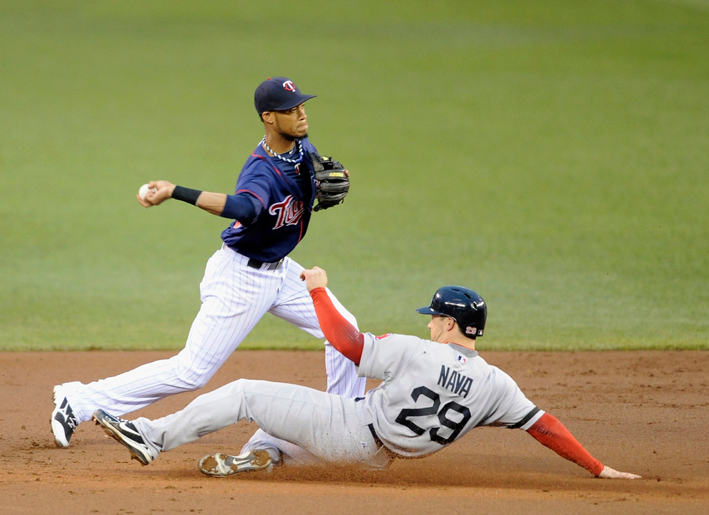 . Daniel Nava of the Boston Red Sox is out at second base as Pedro Florimon of the Minnesota Twins turns a double play in the third inning.  (Photo by Hannah Foslien/Getty Images)
