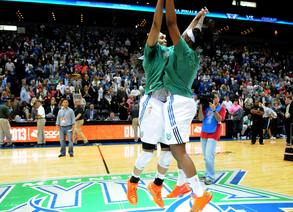 . Lynx teammates Maya Moore, left, and Monica Wright celebrate their 84-59 win over the Atlanta Dream. Moore scored a game-high 23 points, and Wright added 20. (Pioneer Press: Sherri LaRose-Chiglo)