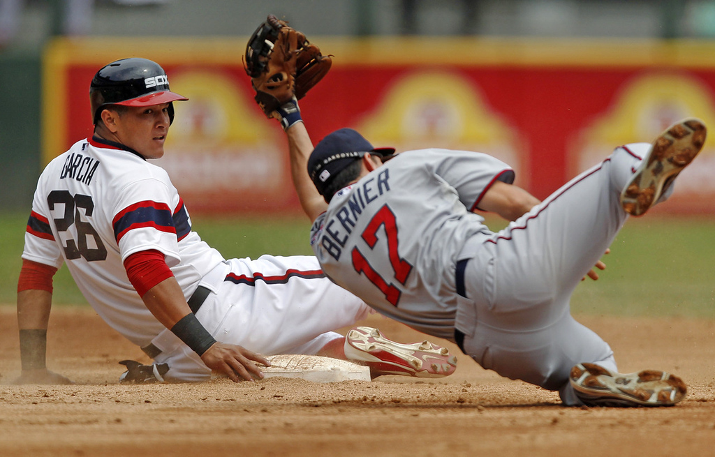 . White Sox base runner Avisail Garcia, left, steals second as Twins shortstop Doug Bernier is late on the tag during the second inning. (AP Photo/Andrew A. Nelles)