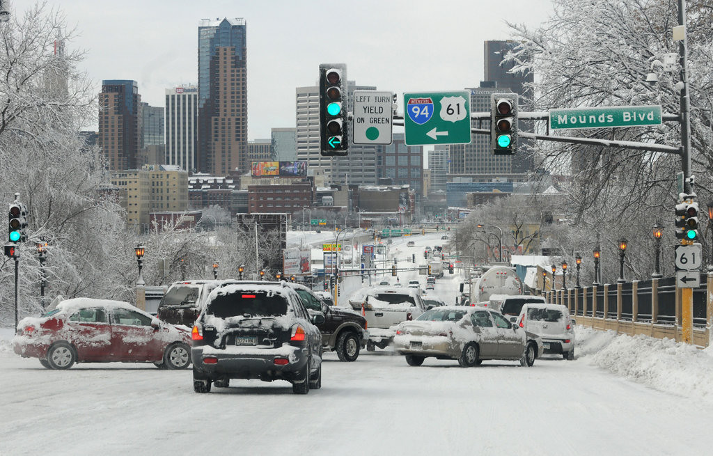 . Traffic moves slowly on East Seventh Street at Mounds Boulevard Friday. Between 2 p.m. Thursday and 6 a.m. Friday, 9.9 inches of snow fell at the Minneapolis-St. Paul International Airport, the official weather observation point for the Twin Cities, according to the National Weather Service.  (Pioneer Press: Jean Pieri)