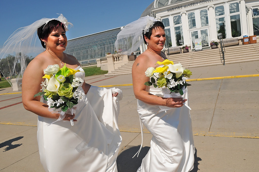 . Rochelle, left, and Shirley walk by the Marjorie McNeely Conservatory in Como Park on their way to get married. (Pioneer Press: Jean Pieri)