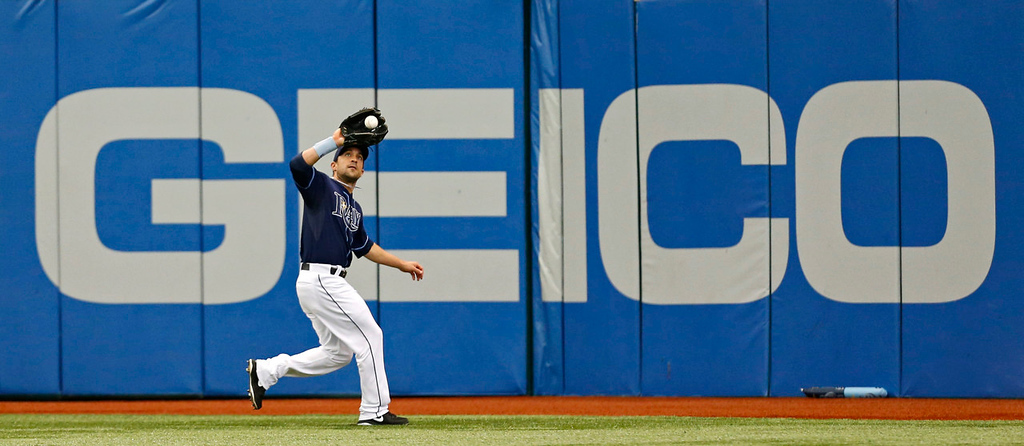 . Tampa Bay center fielder Sam Fuld makes a catch on a fly ball from Minnesota\'s Aaron Hicks during the third inning. (AP Photo/Mike Carlson)