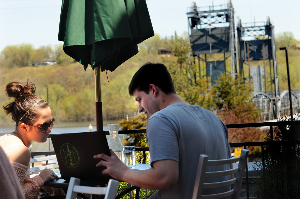 . Stillwater\'s lift bridge looms behind Emily Wilmes and her boyfriend, Ryan Neumann, both of Bayport, dining at the Green Room\'s rooftop patio in Stillwater on May 15, 2013. (Pioneer Press: Jean Pieri)