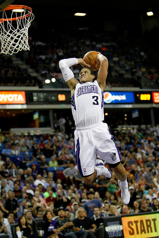 . Sacramento Kings guard Ray McCallum breaks away for a dunk against the Minnesota Timberwolves during the second half as the Kings won 106-103.(AP Photo/Steve Yeater)