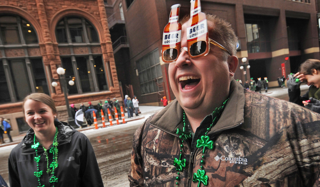 ". Wearing beer goggles which ""improve his vision,\"" Mike Schuetze of Big Lake enjoys  the annual St. Patrick\'s Day parade.  (Pioneer Press: Scott Takushi)"