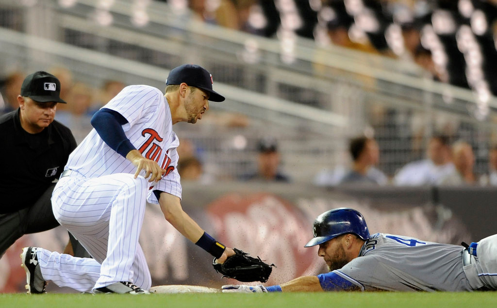 . Trevor Plouffe #24 of the Minnesota Twins tags out Alex Gordon #4 of the Kansas City Royals at third base during the eighth inning. (Photo by Hannah Foslien/Getty Images)
