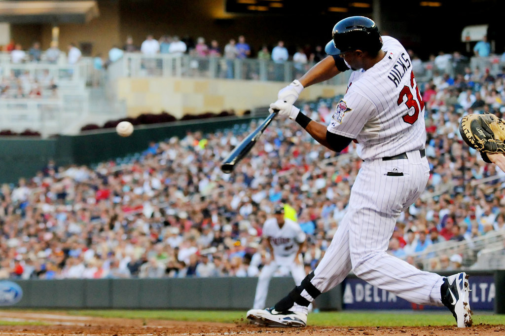 . Aaron Hicks hits a double against New York starting pitcher Phil Hughes during the third inning. (Pioneer Press: John Autey)