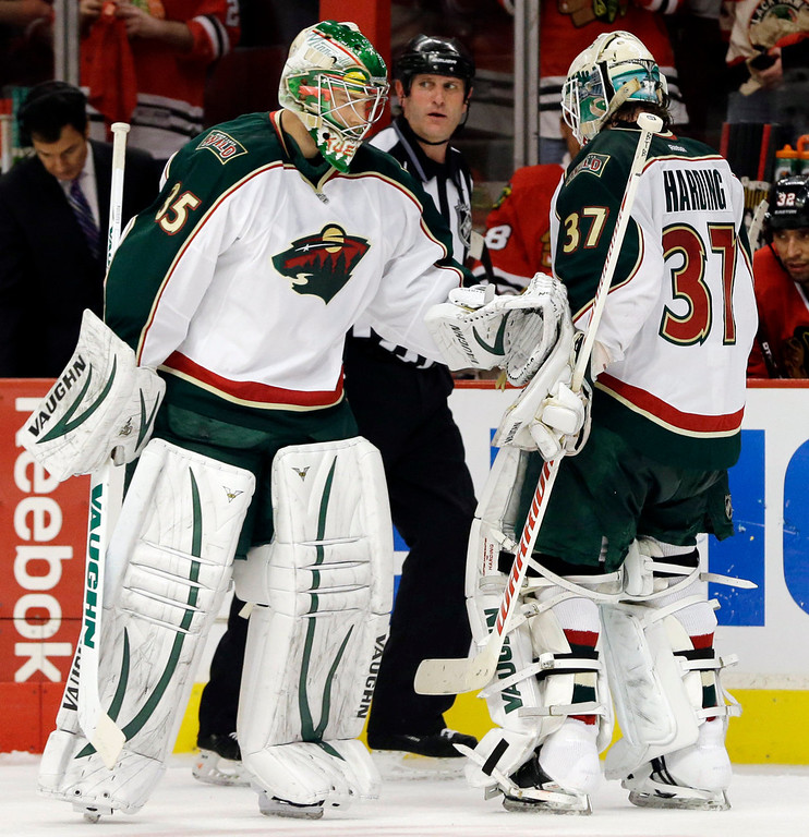 . Minnesota Wild goalie Darcy Kuemper (35) replaces goalie Josh Harding (37) during the second period. (AP Photo/Nam Y. Huh)