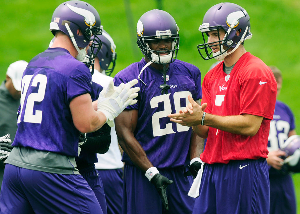 . From left, tight end Kyle Rudolph, running back Adrian Peterson and quarterback Christian Ponder huddle.  (Pioneer Press: Scott Takushi)