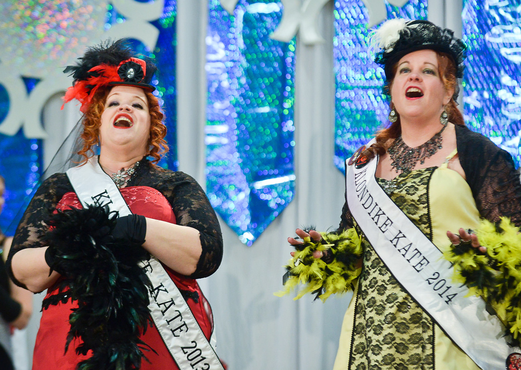 . The 2014 Klondike Kate, Kathy Rustin-Westphal of St. Paul Park, right, serenades the audience with outgoing Klondike Kate, Anita Mack of St. Paul, during the Senior Royalty Coronation ceremony. (Pioneer Press: Ben Garvin)