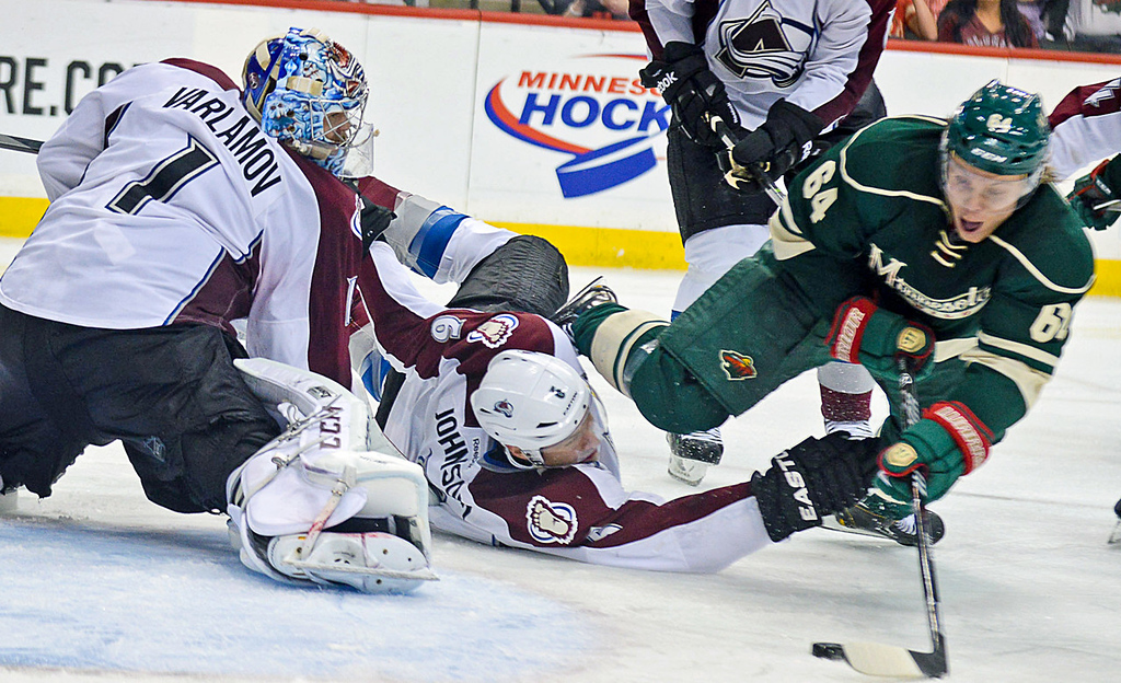. Minnesota Wild center Mikael Granlund, right, shoots a wrist shot over the outstretched arms of Avalanche defenseman Erik Johnson and past goalie Semyon Varlamov to beat the Avs, 1-0 in overtime, in Game 3.  (Pioneer Press: Ben Garvin)