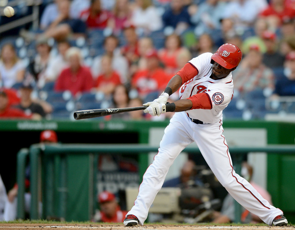 . Washington Nationals left fielder Roger Bernadina (33) drops a bloop single into left field against the Minnesota Twins in the first inning of the second game of a day-night doubleheader. (Chuck Myers/MCT)