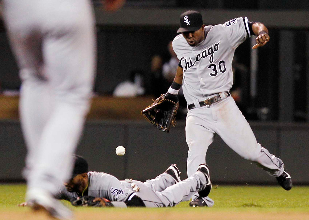 . Chicago White Sox center fielder Alejandro De Aza (30) and Alexei Ramirez, left, drop a pop fly against the Minnesota Twins during the eighth inning of a baseball game, Monday, May 13, 2013, in Minneapolis. The Twins won 10-3. (AP Photo/Genevieve Ross)