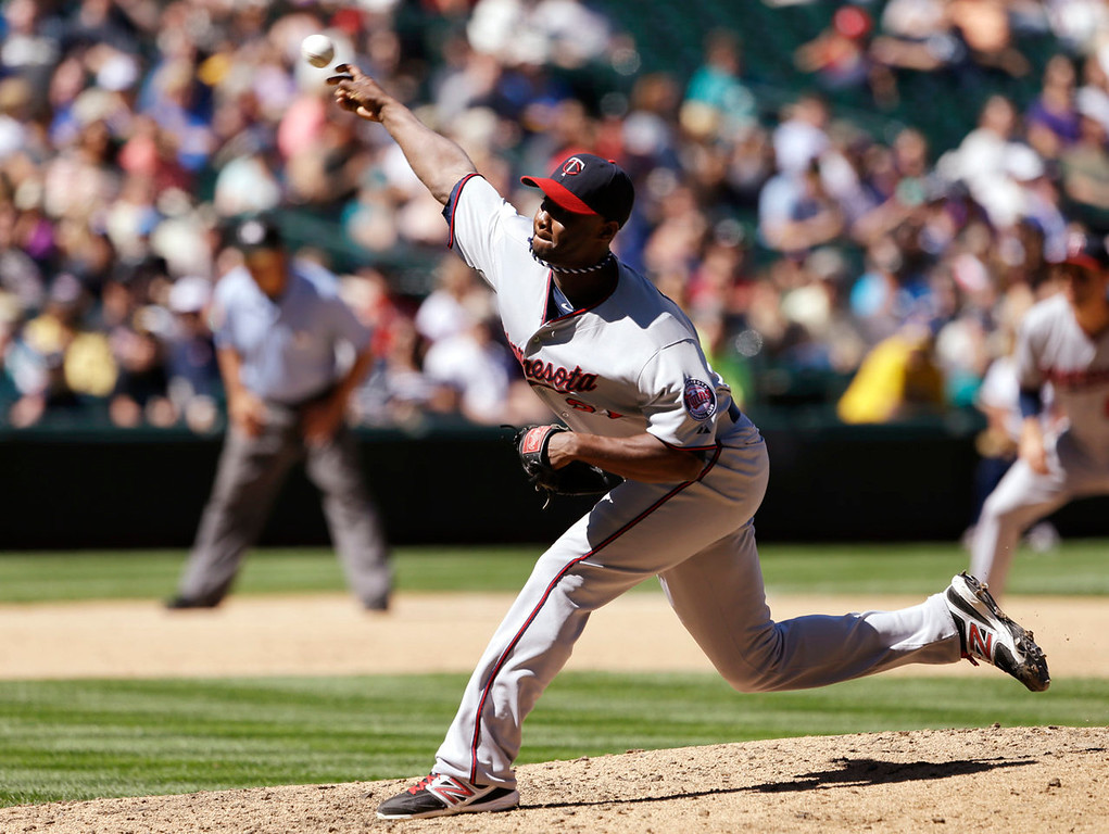 . Minnesota Twins starting pitcher Samuel Deduno throws against the Seattle Mariners in the sixth inning. (AP Photo/Elaine Thompson)