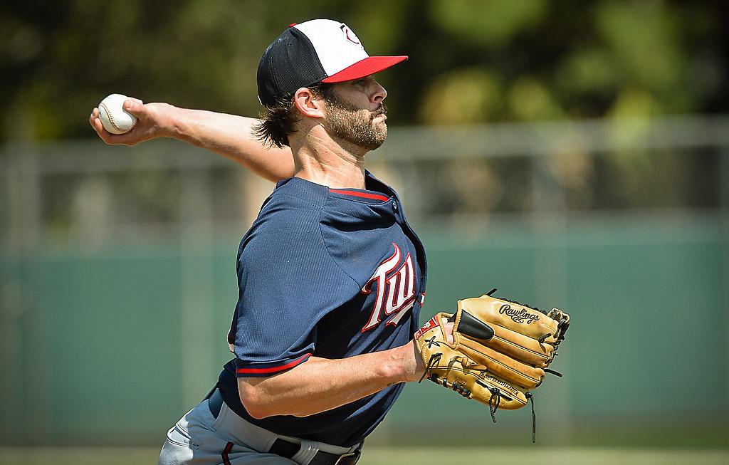 . Non-roster invitee Aaron Thompson hurls during live batting practice. (Pioneer Press: Ben Garvin)