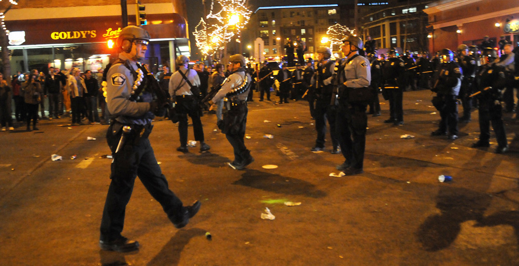 . Minneapolis police secure the intersection after taking it back from fans on Saturday night in Dinkytown. (Pioneer Press: Sherri LaRose-Chiglo)