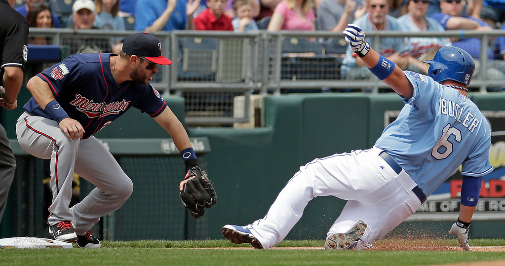 . Kansas City Royals\' Billy Butler (16) beats the tag by Minnesota Twins third baseman Trevor Plouffe as he advances on a double by Justin Maxwell during the second inning. (AP Photo/Charlie Riedel)