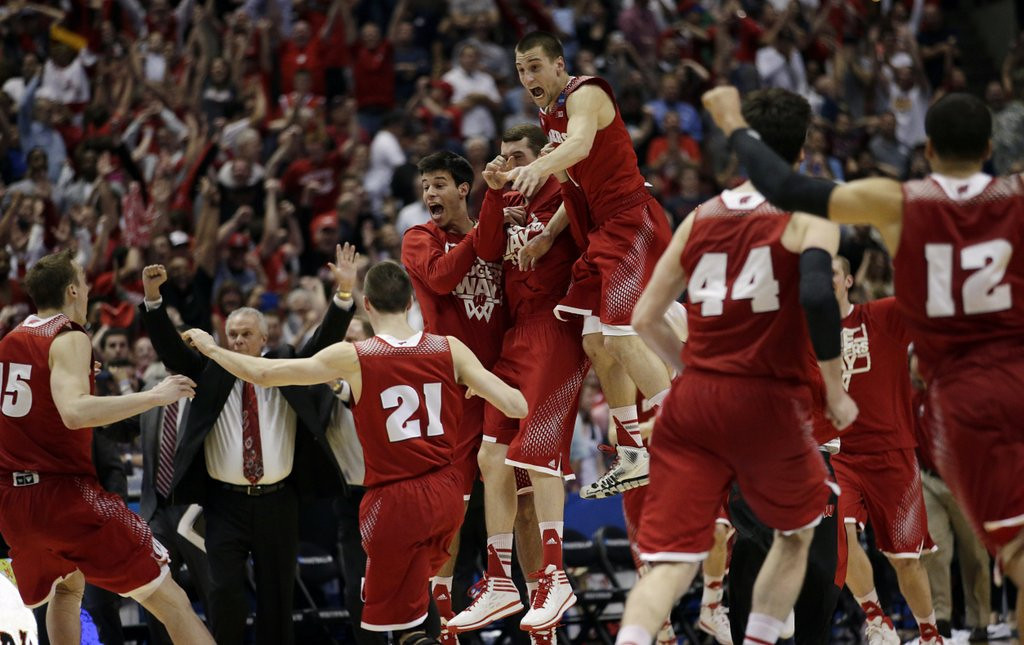 """. <p><b> Wisconsin sports fans have been dancing in the streets the past few days because � </b> <p> A. The Badgers advanced to Final Four in men�s basketball <p> B. The Badgers football team is looking strong heading into spring practice <p> C. Ryan Braun went two days without flunking another drug test <p><b><a href=\' http://www.twincities.com/sports/ci_25457514/wisconsin-badgers-bigger-goals-lie-ahead\' target=\""""_blank\"""">HUH?</a></b> <p>   (AP Photo/Jae C. Hong)"""