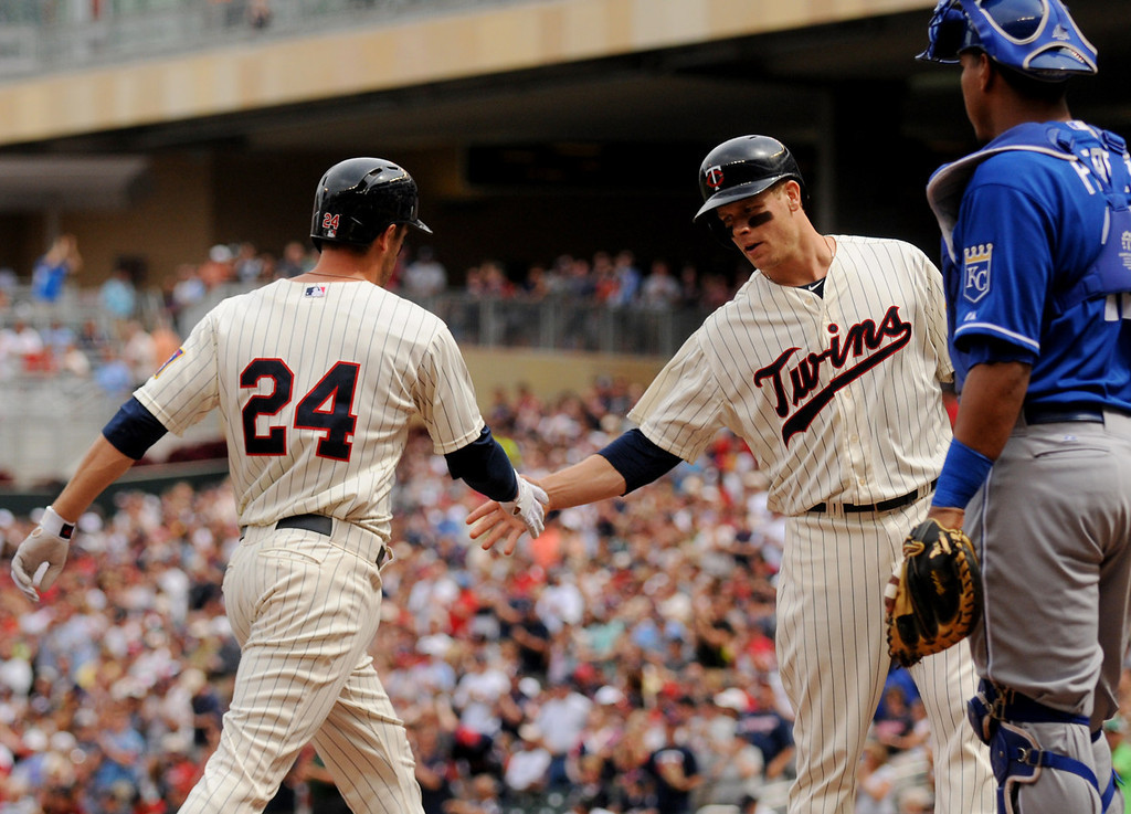 . Minnesota\'s Trevor Plouffe is welcomed home by Justin Morneau after hitting home run during the first inning. (Pioneer Press: John Autey)
