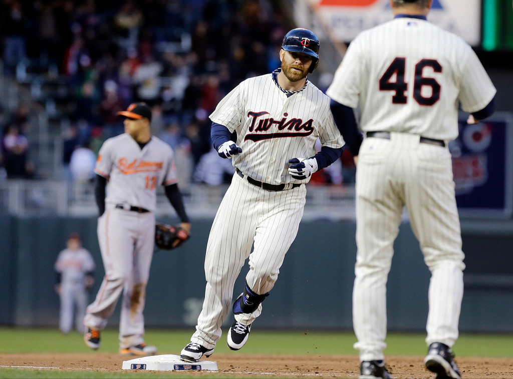 . Minnesota Twins catcher Ryan Doumit rounds third on his two-run home run off Baltimore Orioles pitcher Troy Patton in the sixth inning of a baseball game, Saturday, May 11, 2013 in Minneapolis. The Twins won 8-5. (AP Photo/Jim Mone)