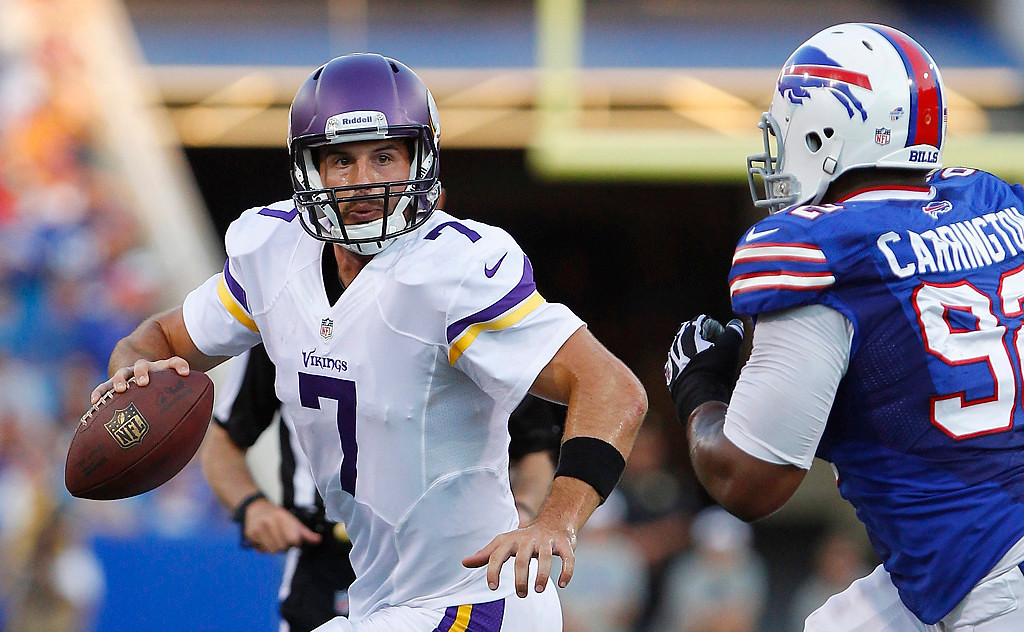 . Minnesota Vikings\' Christian Ponder (7) is chased by Buffalo Bills\' Alex Carrington (92) during the first half of an NFL preseason football game Friday, Aug. 16, 2013, in Orchard Park, N.Y.  (AP Photo/Bill Wippert)