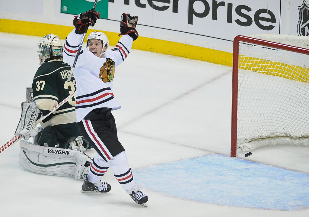 . Chicago center Andrew Shaw reacts after teammate Duncan Keith scored on Wild goalie Josh Harding in the third period. (Pioneer Press: Ben Garvin)