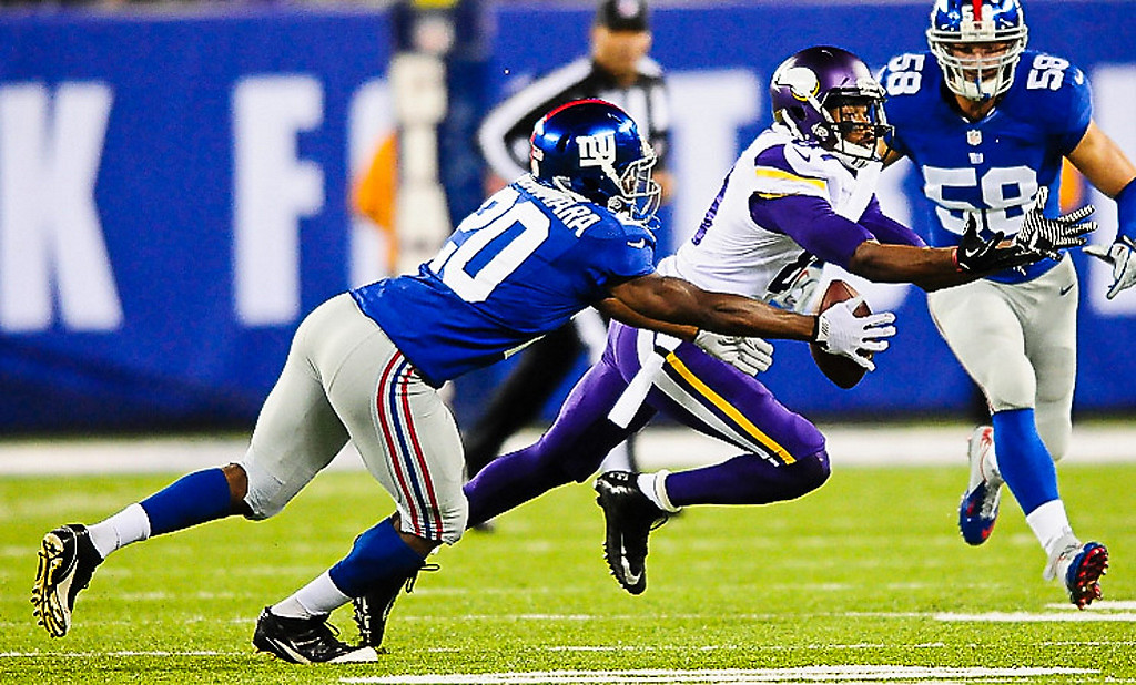 . Giants cornerback Prince Amukamara breaks up a pass to Minnesota\'s Jerome Simpson during the second quarter.  (Pioneer Press: Ben Garvin)