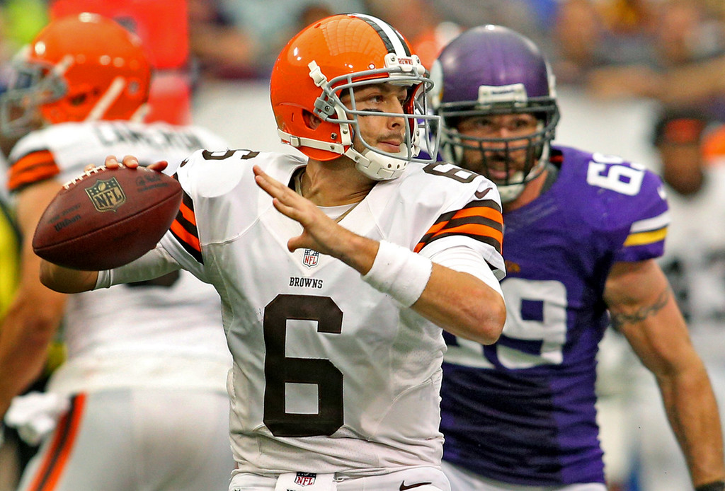 . Browns quarterback Brian Hoyer looks to pass while under pressure from Vikings defensive end Jared Allen during the first half. (Photo by Adam Bettcher/Getty Images)