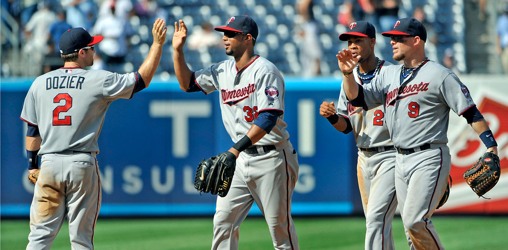 . Twins players, from left, Brian Dozier, Aaron Hicks, Pedro Florimon and Ryan Doumit celebrate Minnesota\'s 10-4 win over the New York Yankees at Yankee Stadium in New York on Sunday, July 14, 2013. Hicks hit a three-run home run off Yankees starting pitcher C.C. Sabathia. The quartet of players gathered six hits and knocked in six runs in Sunday\'s win.  (AP Photo/Kathy Kmonicek)