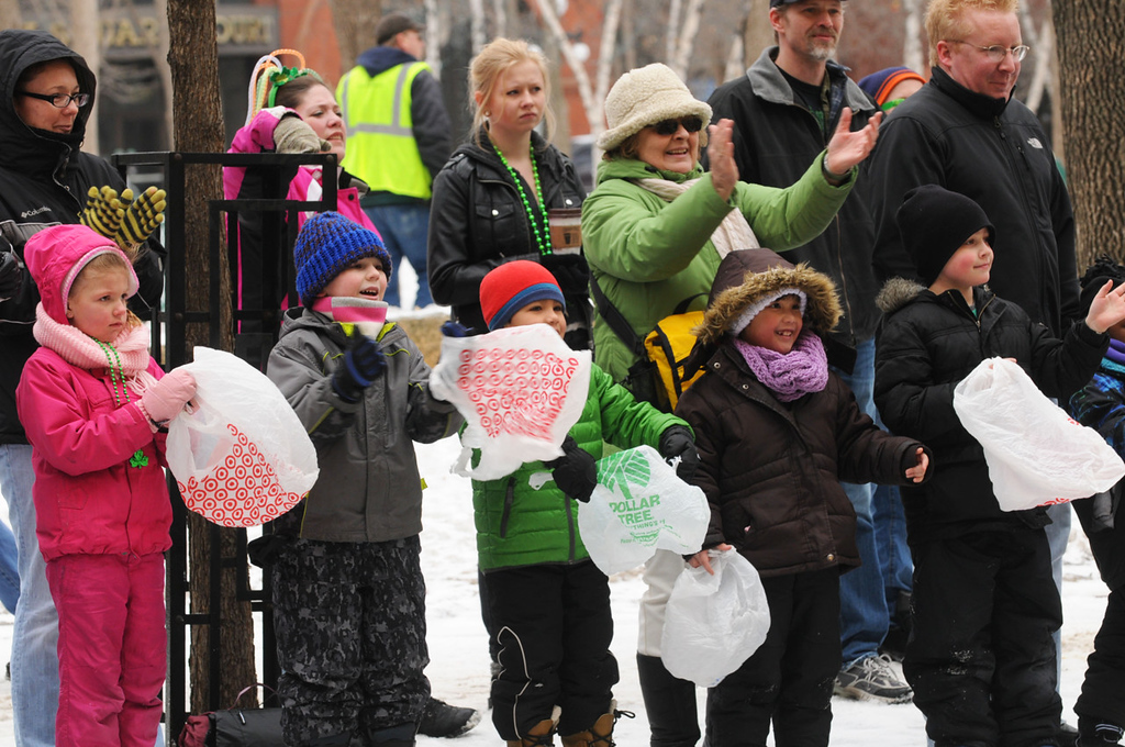 . Kids trolling for candy line the St. Patrick\'s Day parade route along East Fifth Street.  (Pioneer Press: Scott Takushi)