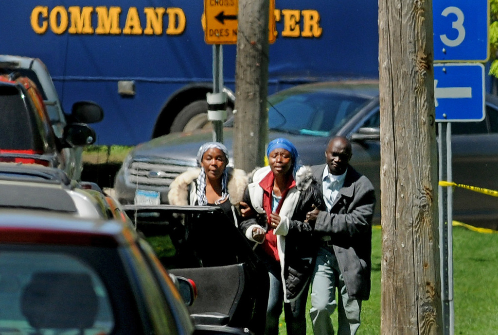 . Madousu Kanneh, center, the mother of landslide victim Zack Mohamed Fofana, 10, is helped to a car on Annapolis Street in St. Paul on Thursday after her son\'s body was found in Lilydale Park. (Pioneer Press: Jean Pieri)
