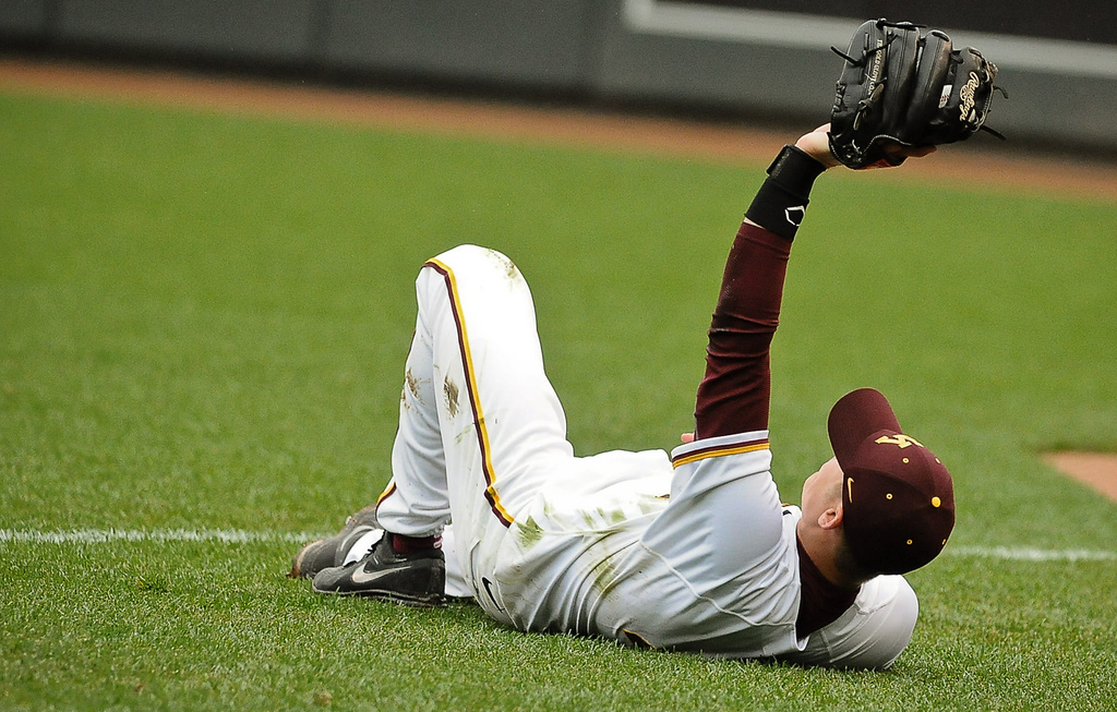 . Gophers second baseman Connor Schaefbauer holds his glove up after making a diving catch in the eighth inning.  (Pioneer Press: Ben Garvin)