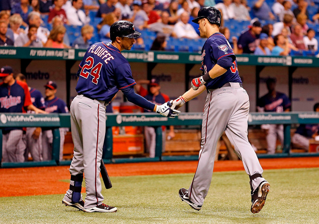 . Infielder Justin Morneau #33 of the Minnesota Twins is congratulated by Trevor Plouffe #24 after his fourth inning home run. (Photo by J. Meric/Getty Images)